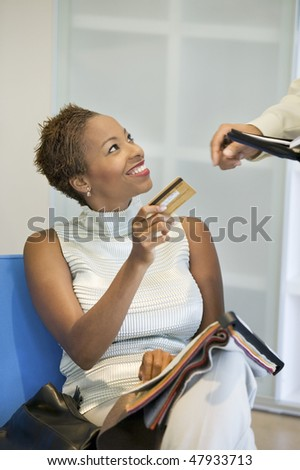 Woman Making a Purchase With Credit Card - stock photo