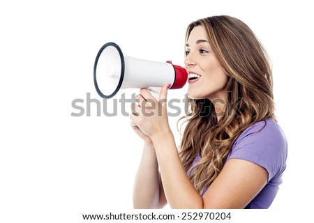 Woman making advertising with megaphone - stock photo