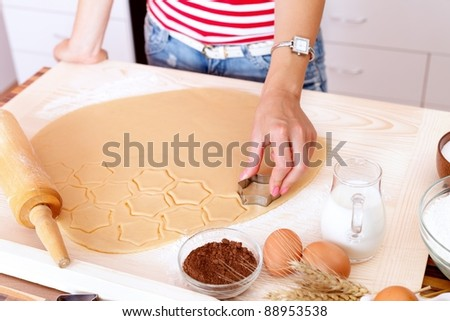 Woman making cake in the kitchen