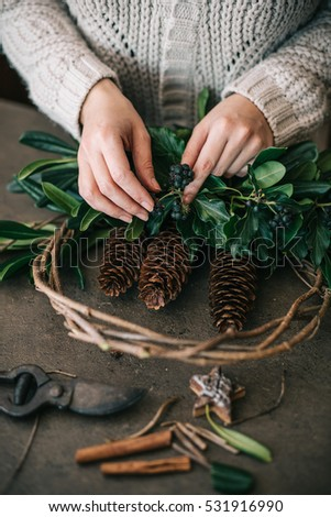 Woman making christmas wreath