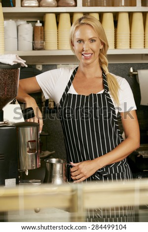 Woman Making Coffee In Shop - stock photo