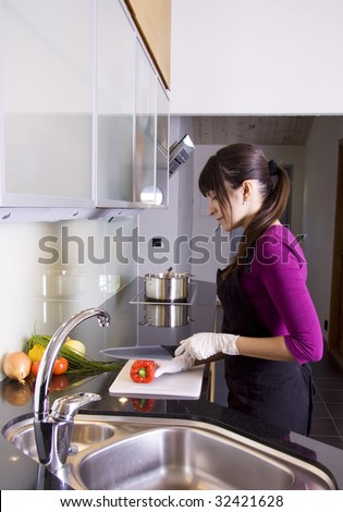Woman making dinner in a modern kitchen