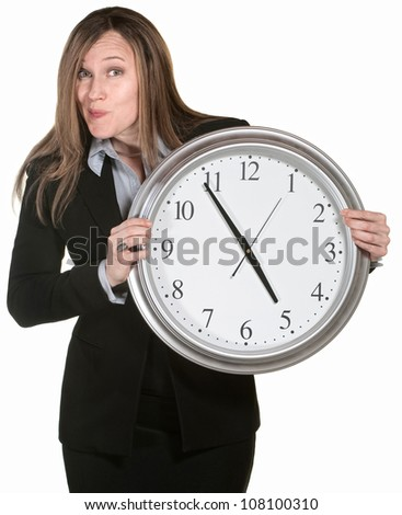 Woman making faces and holding a large analog clock - stock photo