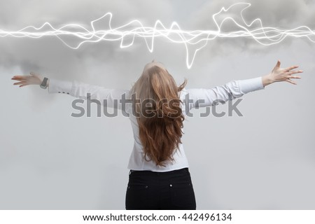 Woman making magic effect - flash lightning. The concept of electricity, high energy. - stock photo