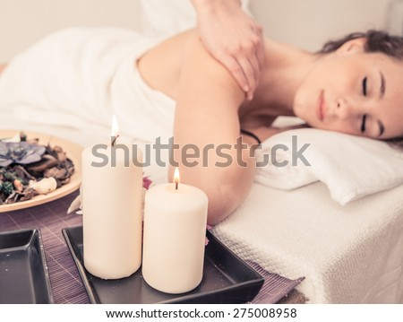 woman making massage in a beauty saloon. concept about spa, relaxation, body care and people - stock photo