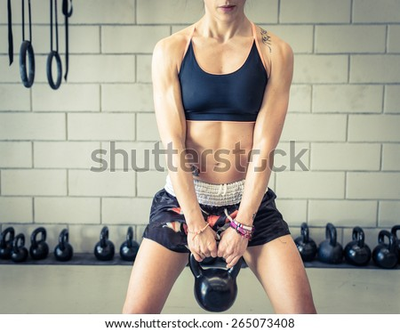woman making power training in the gym. concept about training, martial arts, fitness, sport and people - stock photo
