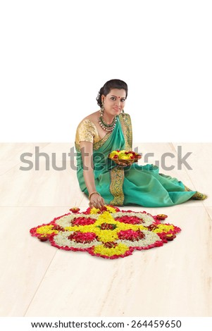 woman making rangoli for diwali - stock photo