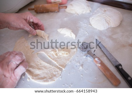 woman making rolls baking in the kitchen hands detail cooking