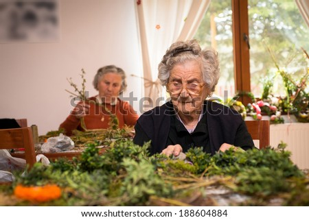 Woman making some easter decorations - stock photo