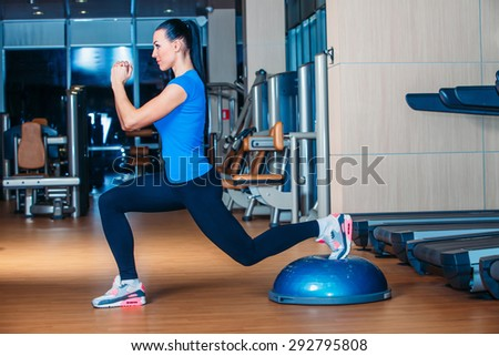 Woman making squats on balance trainer fg fgf fgfg  - stock photo