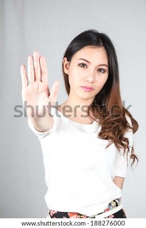 Woman making stop gesture with her hand isolated on a white background - stock photo
