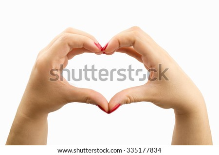 woman making the heart shape with her hands on white background
