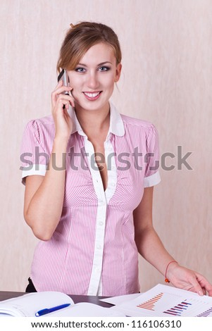 woman manager in office near table speaking phone - stock photo