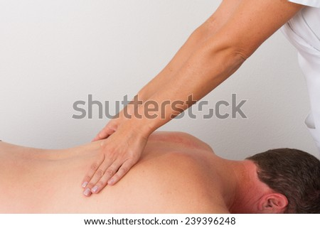 Woman massaging a man - stock photo
