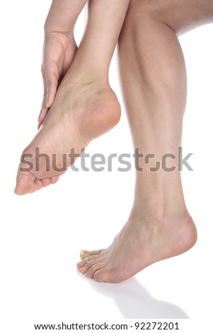 Woman massaging aching feet over white background