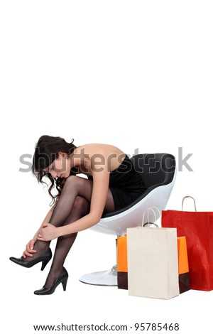 Woman massaging her ankles - stock photo