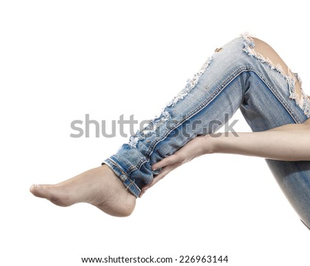 Woman massaging her Calves - Anatomy Muscles because it hurts. - stock photo