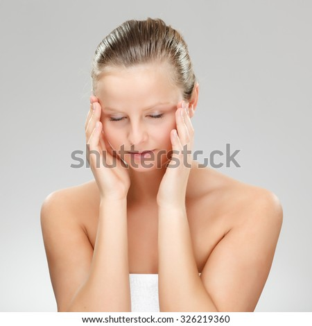 Woman massaging pain head