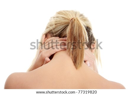 Woman massaging pain in her neck, isolated on white - stock photo