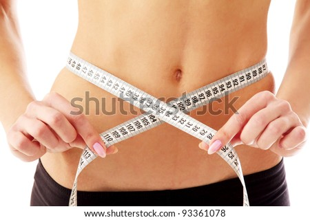 woman measure her waist belly by metre-stick. - stock photo
