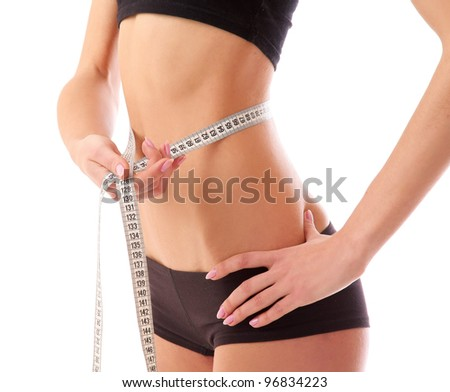 Woman measure her waist belly by metre-stick.