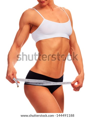 Woman measures her body, white background, copyspace - stock photo