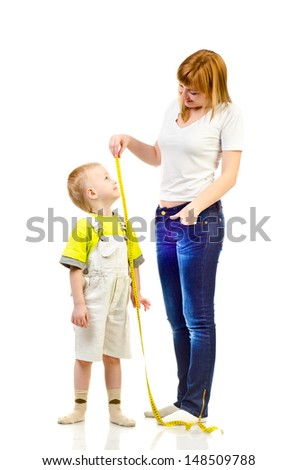 woman measuring child isolated on a white background - stock photo