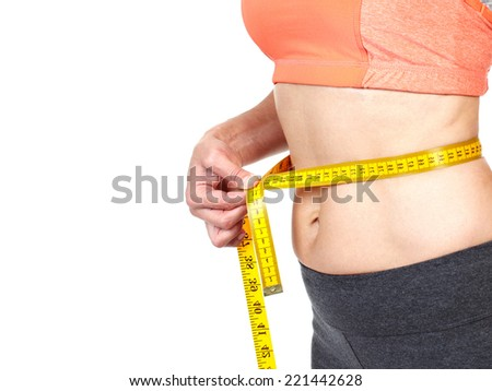 Woman measuring her body. Diet and healthy lifestyle  - stock photo