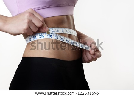 woman measuring her perfect shape body, healthy lifestyles concept