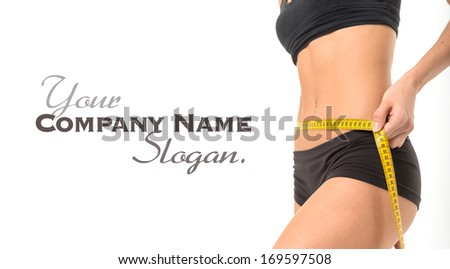 Woman measuring her thin waist - stock photo