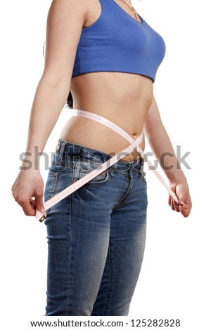 Woman measuring her waist isolated on white background