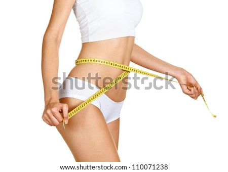 Woman measuring her waistline. Perfect Slim Body. Diet - stock photo