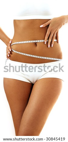 Woman measuring perfect shape of beautiful thigh - stock photo