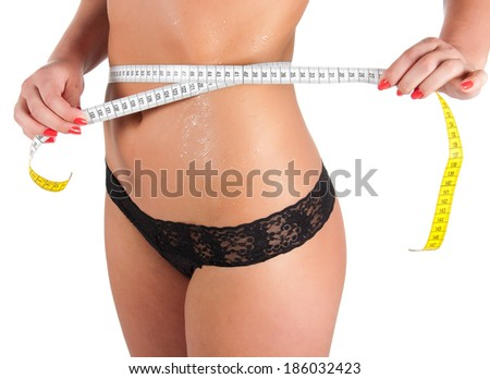woman measuring perfect shape of beautiful thigh healthy lifestyles concept.