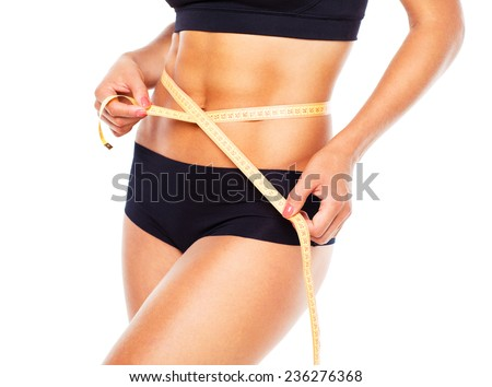 Woman measuring perfect shape of beautiful thigh, healthy lifestyles concept on white - stock photo
