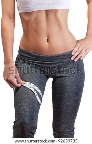 woman measuring thigh