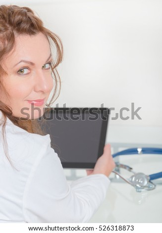 Woman medical doctor using tablet pc at the consulting room