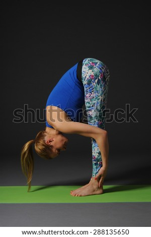 Woman meditating and doing yoga against grey background. - stock photo