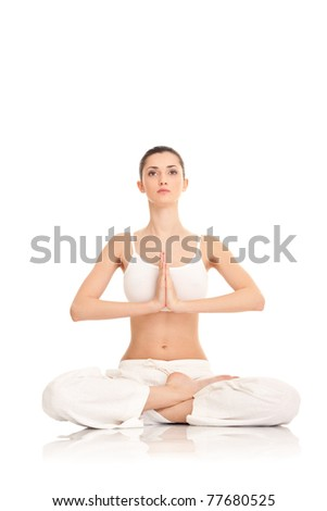 woman meditating in yoga pose, isolated on white positive, - stock photo