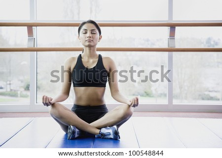 Woman meditating indoors