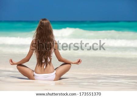 Woman Meditation At Tropical Beach - stock photo