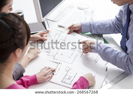 Woman meeting architect for construction project