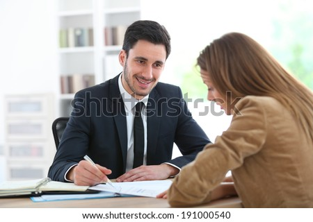 Woman meeting financial adviser in office - stock photo