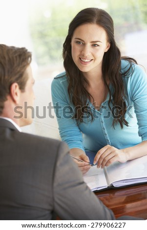 Woman Meeting With Financial Advisor At Home