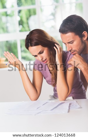 Woman misunderstanding the finances with her partner - stock photo