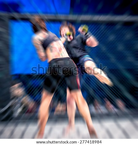 Woman mixed martial artist in action of fight. Zoom blur. - stock photo