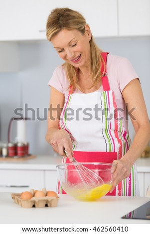 woman mixing bake mix in a translucent bowl