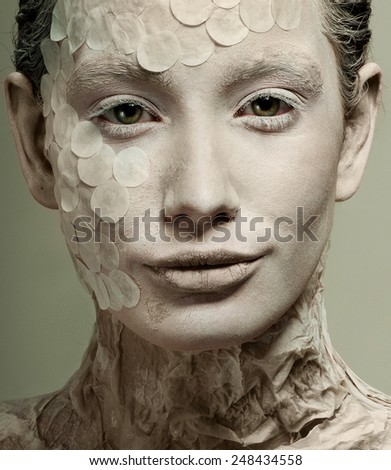 Woman model in the form of a snake. Fashion. Body painting. - stock photo