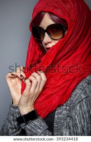 Woman modeling modern Persian fashion with head scarf or Hijab.  The image depicts conservative tradition applied to modern progressive fashion.