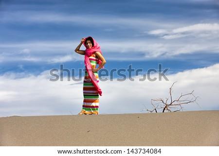 Woman models in desert. - stock photo